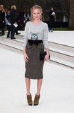 For the Burberry runway show in February 2012, Kate went head to toe in the brand, wearing a cheeky gray owl sweater tucked into a knee-length wool peplum pencil skirt.