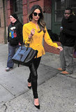 Lily Aldridge brightened up a pair of slick leather pants by adding a pleated yellow Alexander Wang blouse. It's a look that's equal parts edgy and sweet.