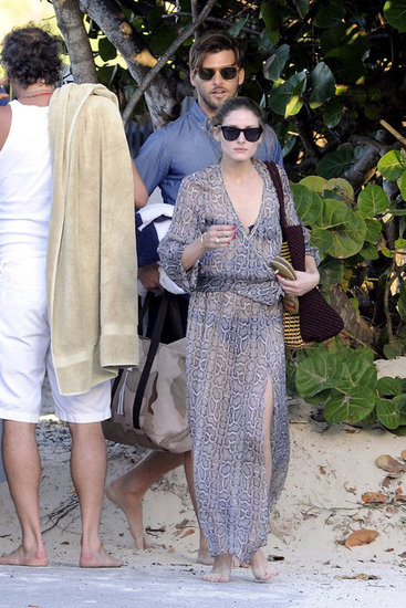Olivia Palermo covered up the glamorous way in St. Barts in a breezy, animal-print caftan.