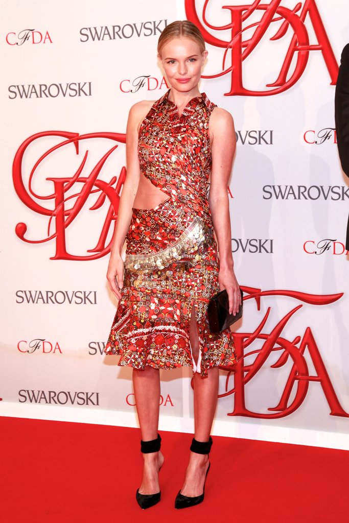 Only Kate could have pulled off the heavily embellished, printed, cutout Altuzarra dress that she wore to the CFDA Fashion Awards back in June 2012. She kept her accessories minimal, opting for a black clutch and pointy ankle-strap pumps.