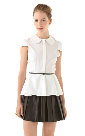 This Alice + Olivia peplum top ($198) reminds us of our school days. It will lend instant femininity to any bottom, and we adore the Peter Pan collar and the metal belt.