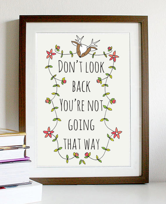 "Keep your goals in mind with this print ($15) that reads, ""Don't look back; you're not going that way."""