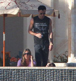 Justin Theroux and Jennifer Aniston talked on the terrace.