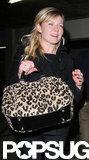 Kirsten Dunst carried a leopard bag.