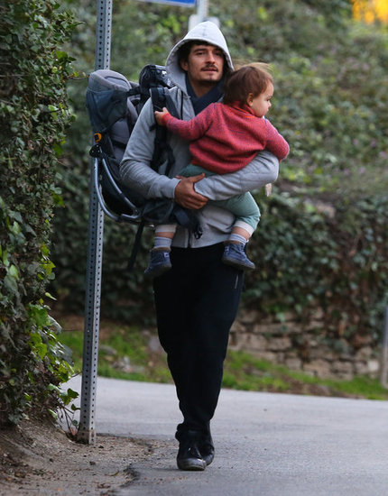 Orlando Bloom carried a backpack.