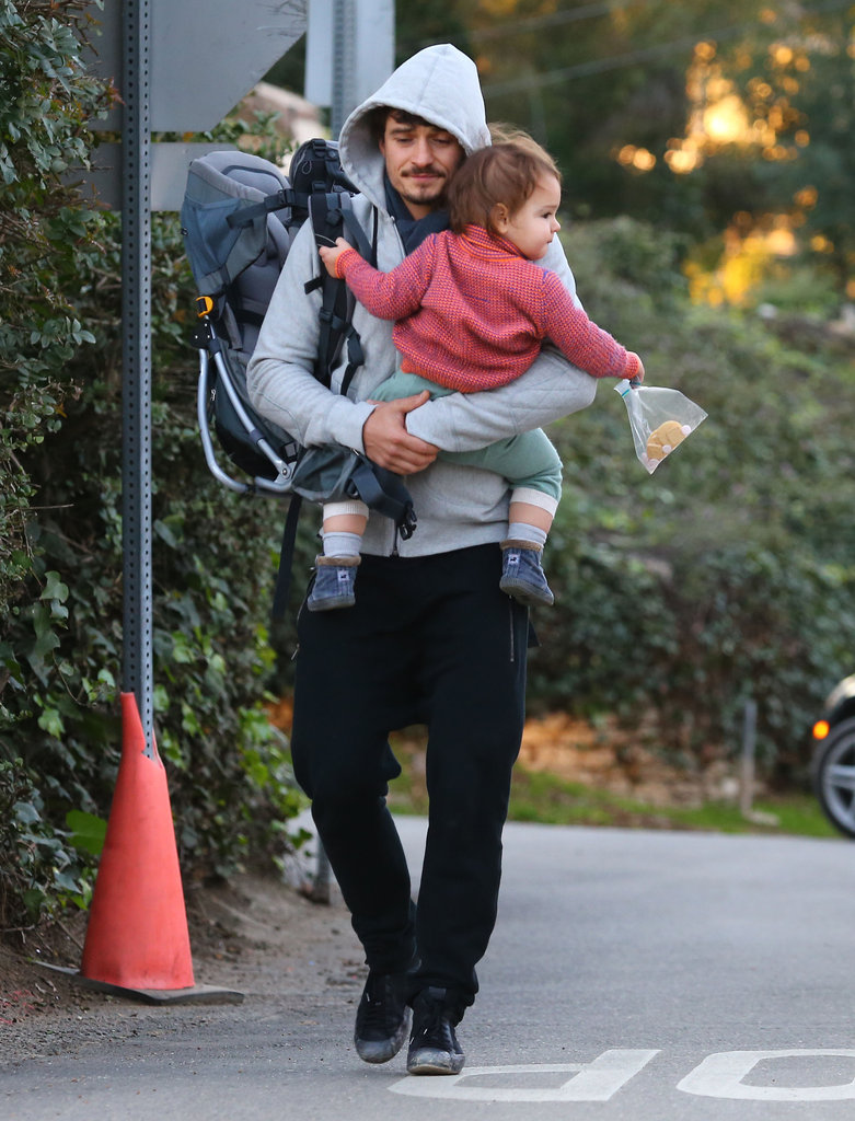 Flynn played with some snacks during a walk with dad Orlando Bloom.
