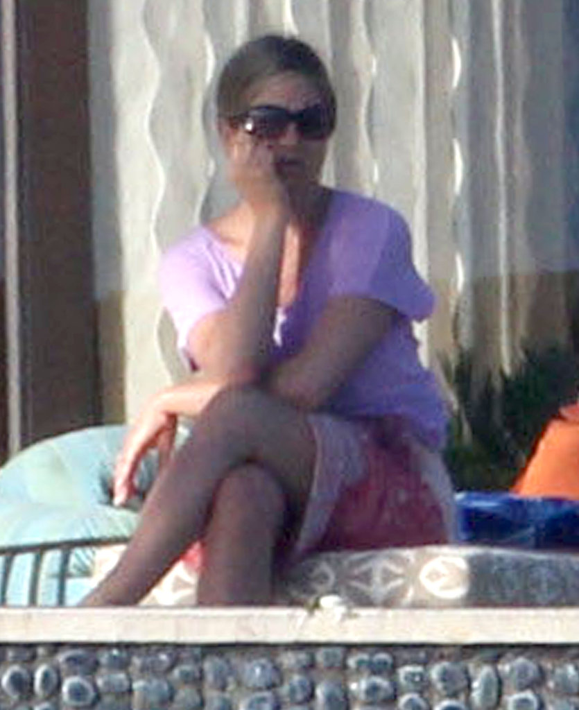 Jennifer Aniston sat by the pool.