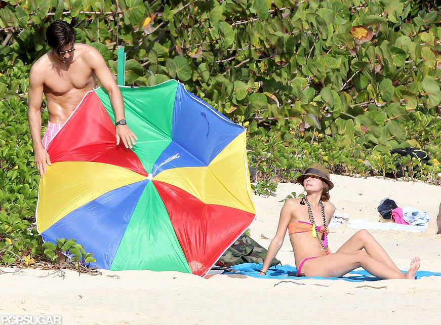 Olivia Palermo's boyfriend, Johanne Huebl, tried to fix their broken beach umbrella while they vacationed together in St. Barts in January.