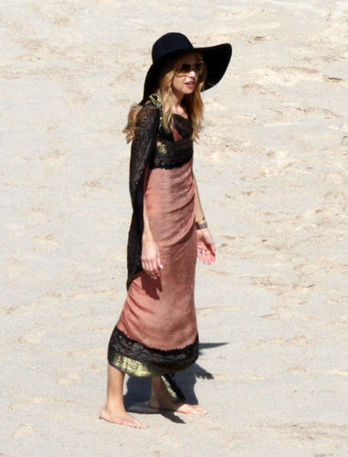 Rachel Zoe took to the beach in St. Barts in style and stayed protected from the sun in her floppy hat and bohemian-feeling sarong.