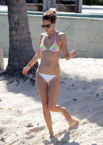 Alessandra Ambrosio hit St. Barts in a rainbow-bright bikini top and white string bikini bottoms, the perfect California-girl suit.