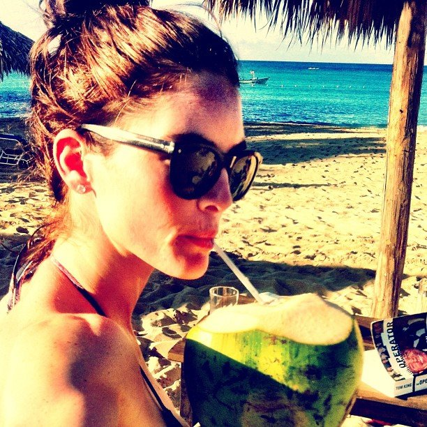 "Hilary Rhoda tapped into her new ""a coconut a day"" resolution while on vacation. Source: Instagram user hilaryhrhoda"