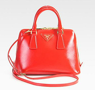 Prada's red Saffiano top handle bag ($1,395) screams retro from the second you set eyes on it. We adore the fiery red color and its structured silhouette.