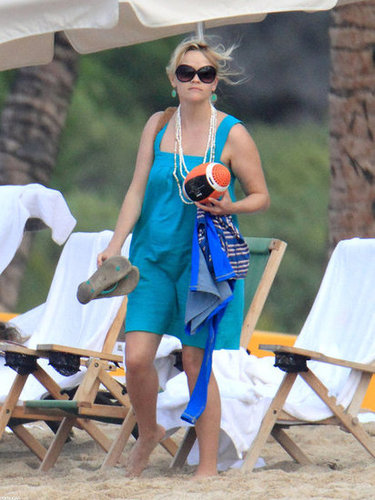 Reese Witherspoon made a sweet, electric blue sundress into the perfect beach look with a few well-placed jewels and oversize shades.
