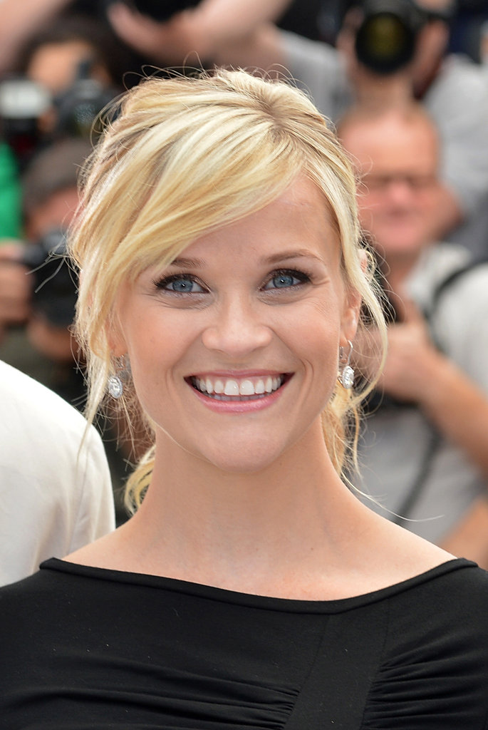 To get Reese Witherspoon's no-frills look, begin by creating a deep side part. Leave a few face-framing layers out in front and pull the rest of the hair back into a loose ponytail. Optional: use a flat iron where needed to form subtle bends within the style.