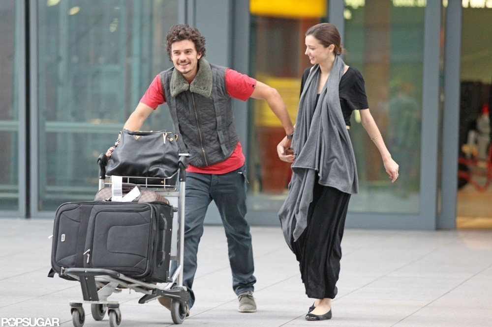 Orlando Bloom and Miranda Kerr reunited at Heathrow Airport in July 2010.