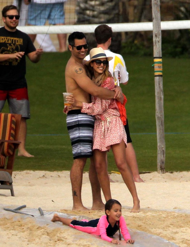 Jessica Alba and Cash Warren hugged while watching their daughter play in Cabo San Lucas, Mexico, during a January 2013 trip.