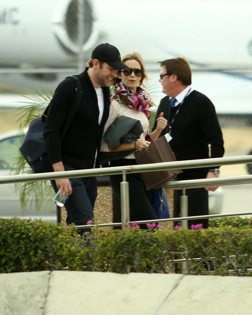 John Krasinski held Emily Blunt close as they left Cabo.