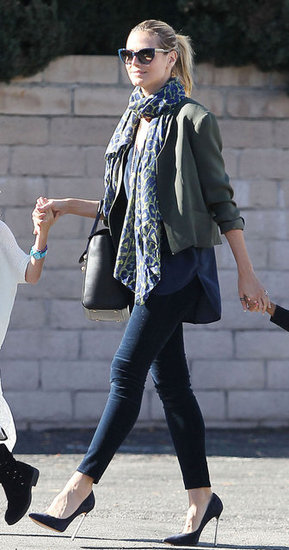 Heidi Klum added a cropped jacket, scarf, and floaty top to her denim for a sophisticated play on light layers.