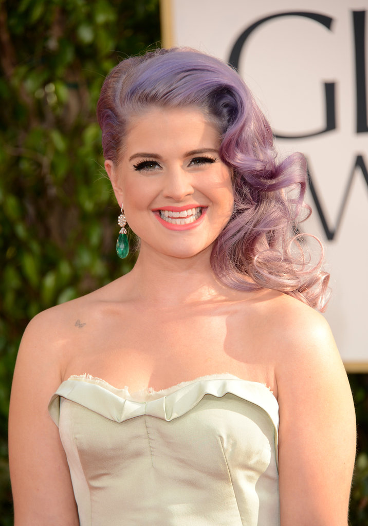 Kelly Osbourne smiled on the red carpet before tracking this year's best dressed stars.