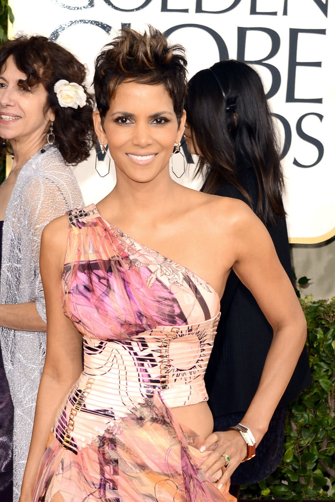 Nahla's mama, Halle Berry, stunned on the red carpet in a nude and pink printed gown by Versace.