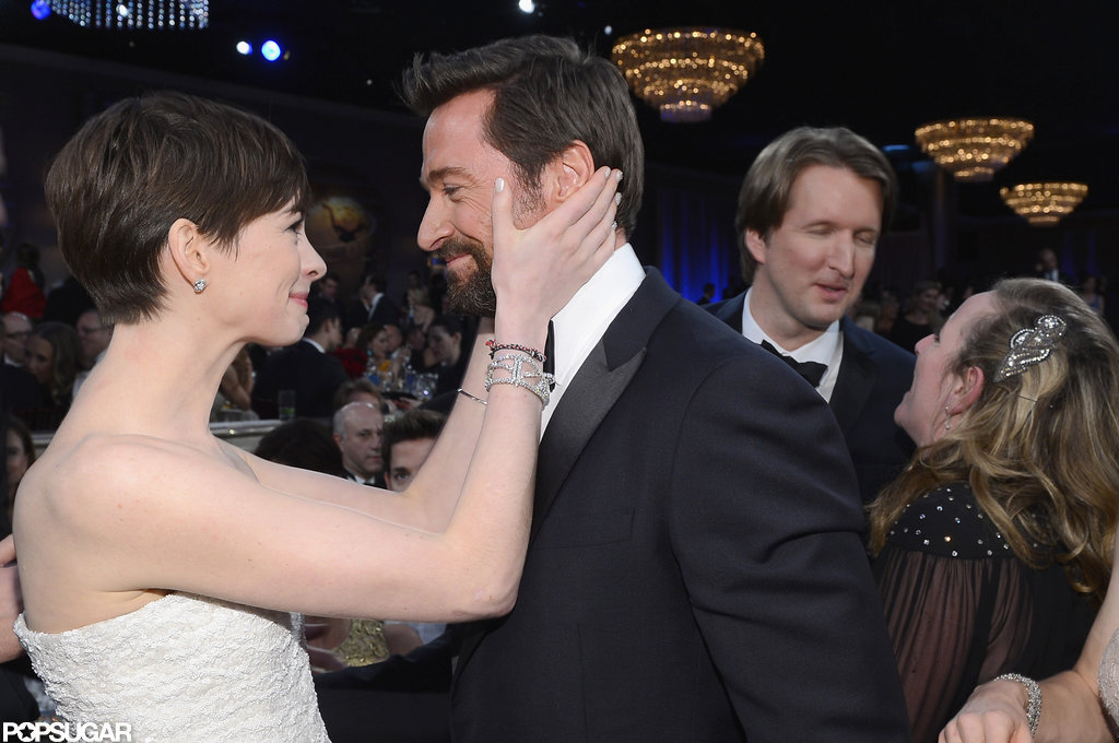 Anne Hathaway shared a moment with her Les Misérables costar Hugh Jackman inside the show.