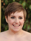 Lena Dunham smiled on the 2013 Golden Globes red carpet.