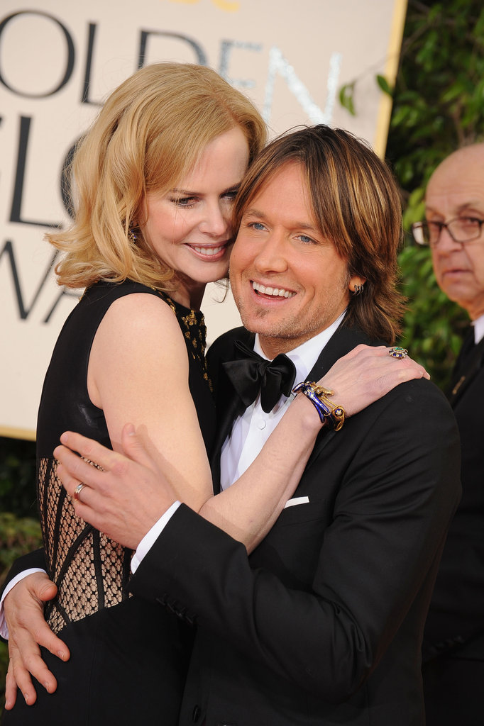 Nicole Kidman and Keith Urban keep close on the red carpet.