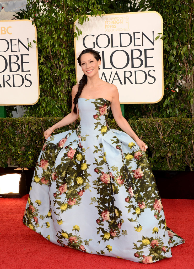 Lucy Liu curtseyed in a floral dress.