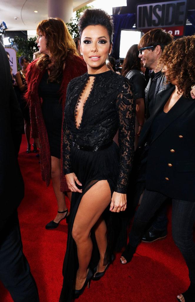 Eva Longoria posed in a black dress at the Golden Globe Awards.