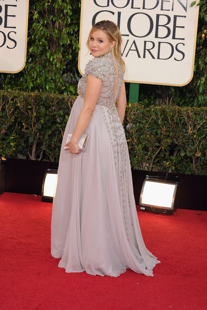 Pregnant Kristen Bell looked back for a couple snapshots before heading inside the 2013 Golden Globe Awards.
