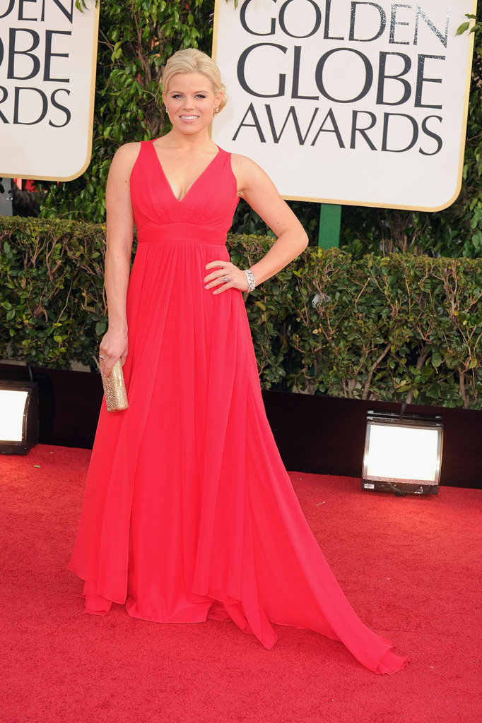 Megan Hilty chose a sweeping red gown for her Golden Globes appearance, only offsetting the stunning look with a gold clutch.