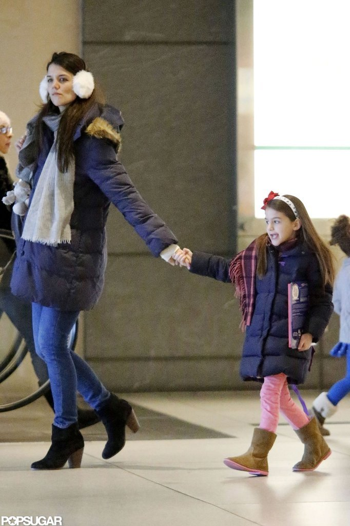 Katie Holmes held onto her daughter Suri Cruise's hand.