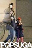 Katie Holmes wore fuzzy white earmuffs.