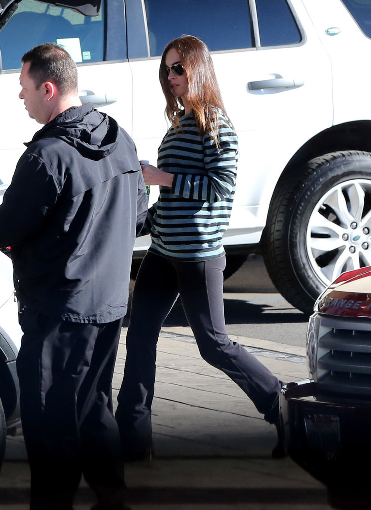 Megan Fox wore a striped sweater and black pants.