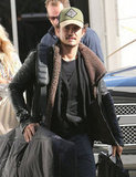 Orlando Bloom headed out of town with his snowboard gear.