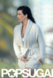 Kim Kardashian wore a cream cardigan over her white bikini in Miami.