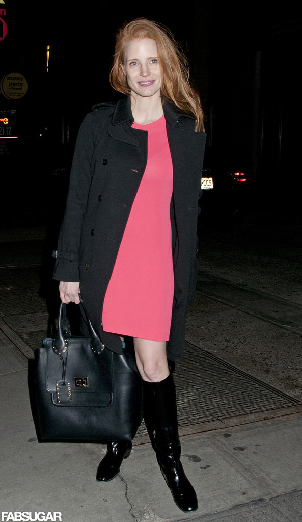 Even when she's working a trifecta of sophisticated pieces (like a sleek black coat, leather tote, and patent leather boots), Jessica knows the value of a punchy accent. This time around, her pink coral shiftdress does the trick.