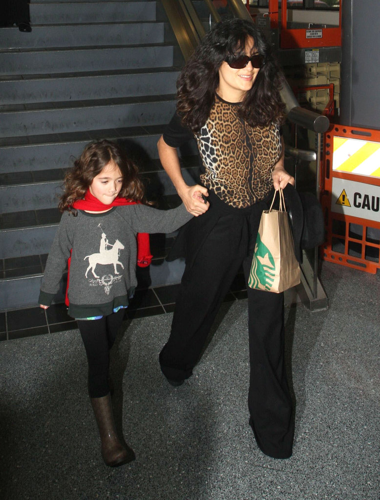 Salma Hayek wore an animal-print blouse.