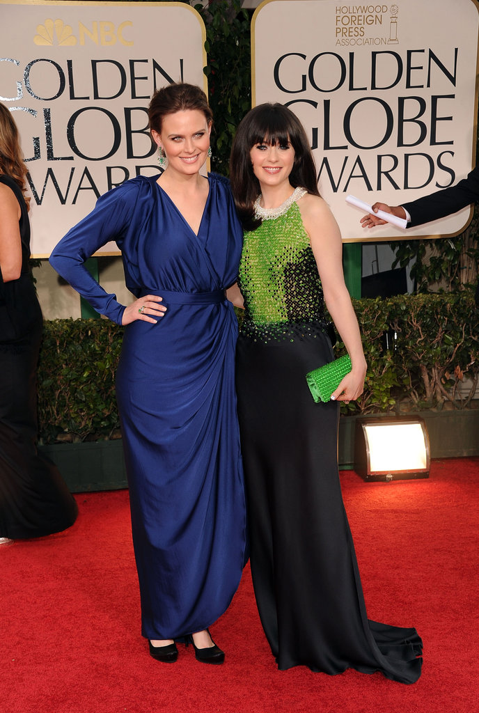 Sisters Emily and Zooey Deschanel linked up on the 2012 red carpet.