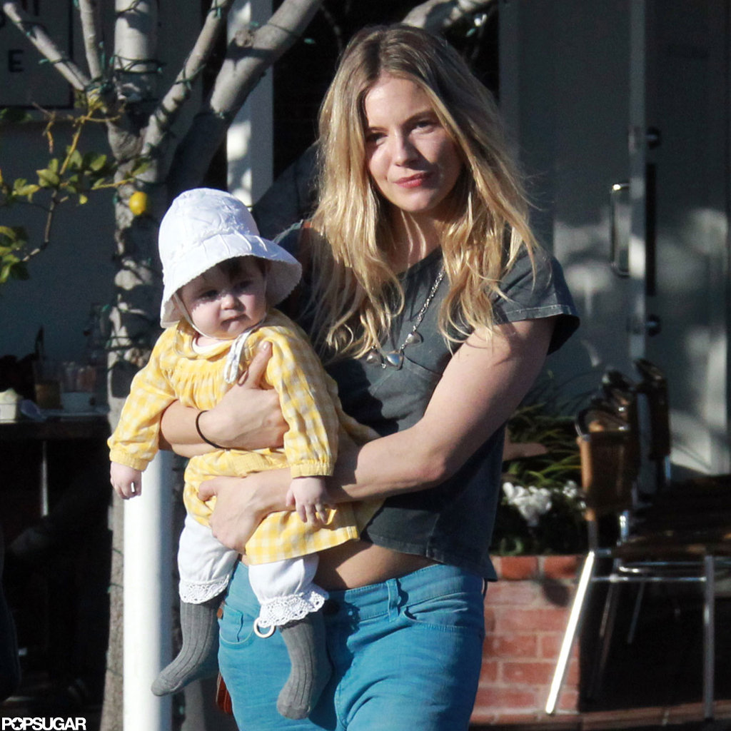Sienna Miller's daughter Marlowe wore a sun hat.