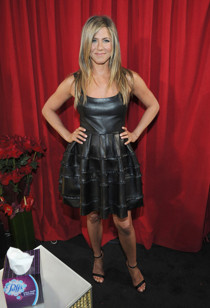 Jennifer Aniston proved the girly silhouette can feel edgy, too, when its crafted in black leather, like her fit-and-flare Dior dress — and finished with sexy ankle-strap heels.