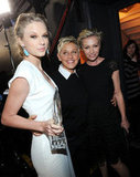 Ellen DeGeneres wrapped her arms around Taylor Swift and wife Portia de Rossi.