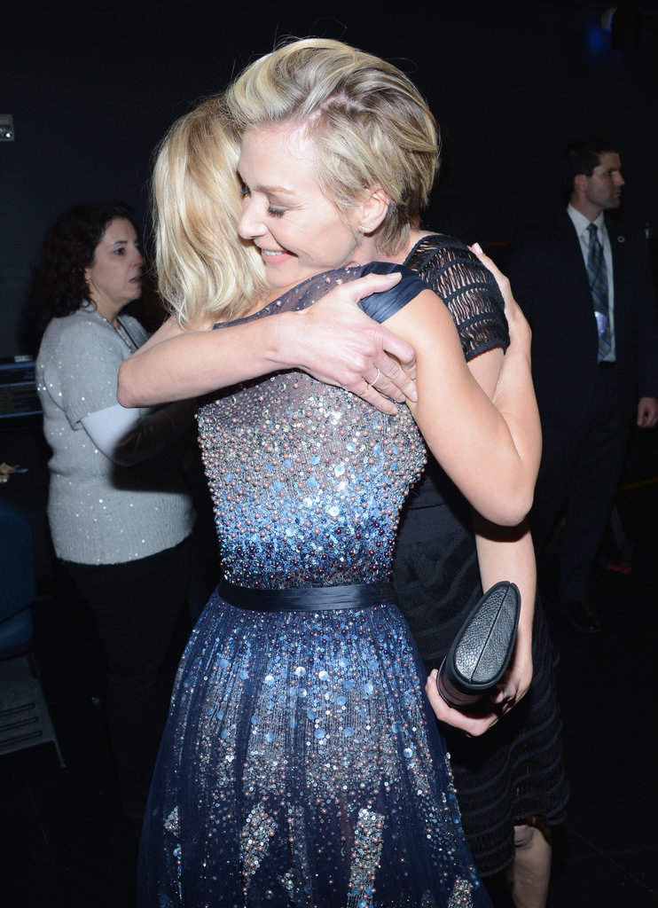 Julianne Hough gets a big hug from Portia de Rossi.