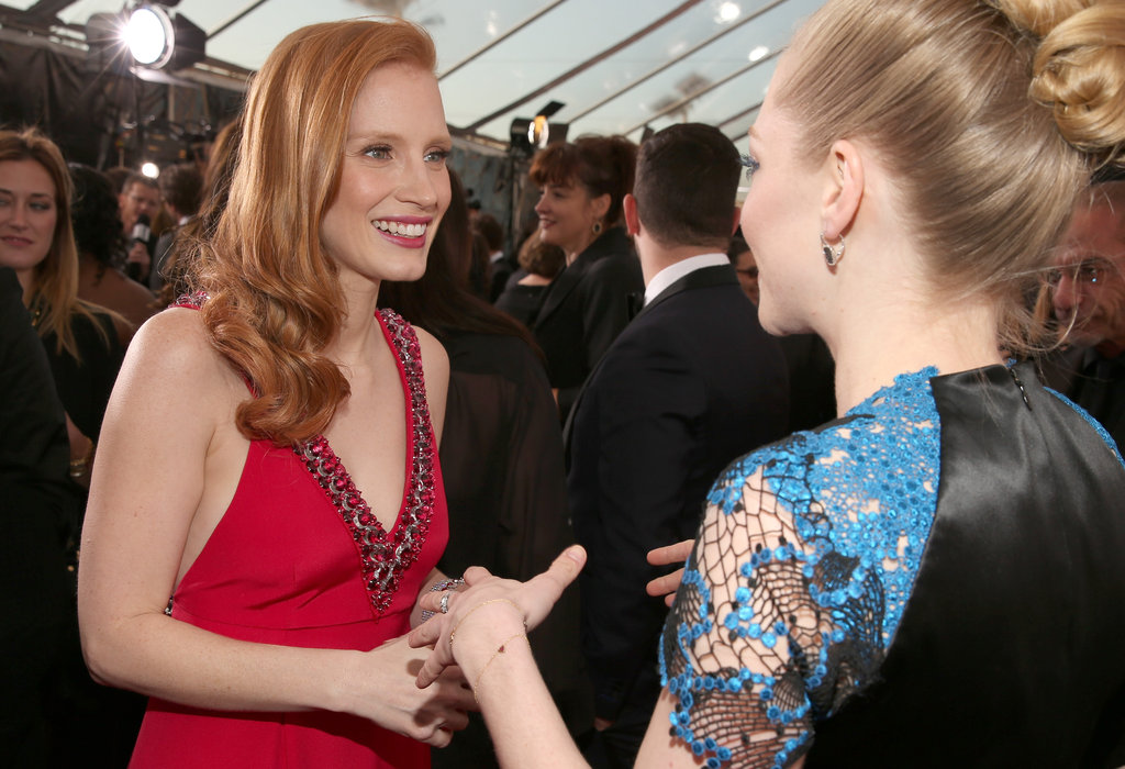 Best actress winner Jessica Chastain chatted with Amanda Seyfried on the red carpet.