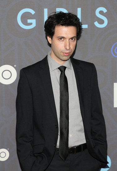 Alex Karpovsky wore a black suit.