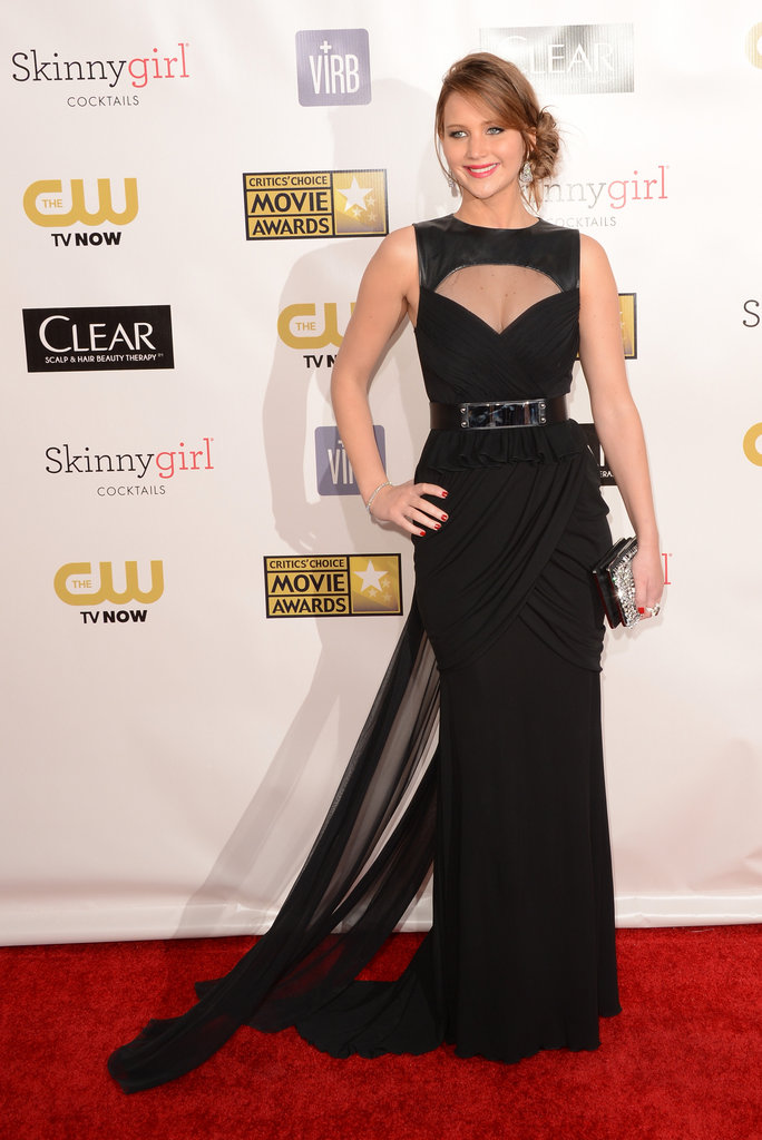 Jennifer Lawrence stepped out in a black Oscar de la Renta gown with a train.