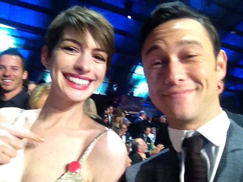 The strap on Anne Hathaway's Oscar de la Renta dress broke at the Critics' Choice Awards — luckily, her good friend Joseph Gordon-Levitt had a pin ready for her! Source: Facebook user Joseph Gordon-Levitt