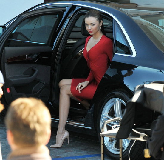 Miranda Kerr wore a red dress on the set of a photo shoot in LA.