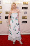 Elle Fanning looked totally playful in a strapless Chanel dress, and it got its youthful vibe from the sweet floral appliqué details down the front.