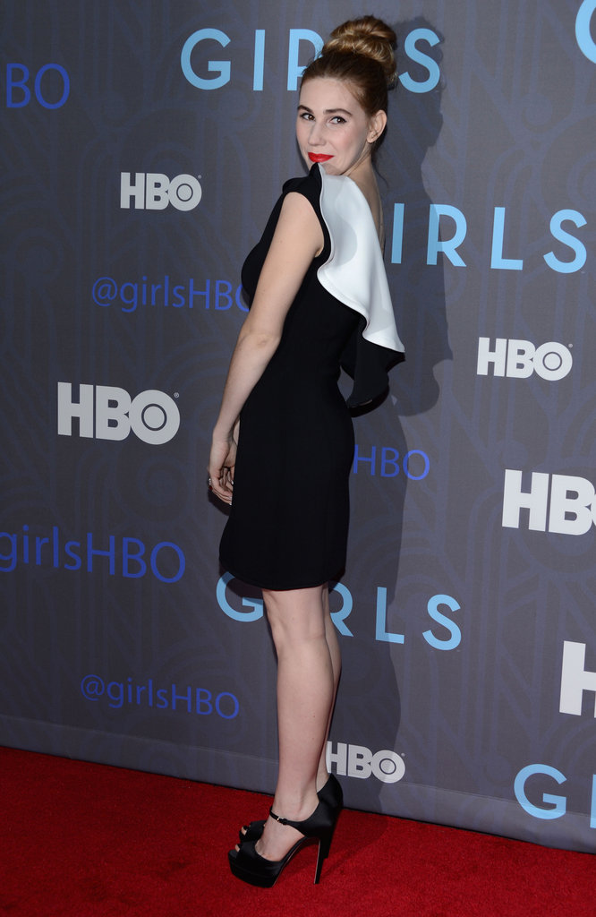 From the back, you can see just how contrasted the white ruffle detail is on Zosia Mamet's minidress.